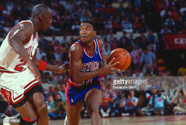 Isiah Thomas of the Detroit Pistons looks to put a move on Michael Jordan of the Chicago Bulls during an NBA basketball game circa 1992 at Chicago...