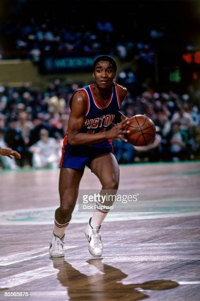 Isiah Thomas of the Detroit Pistons moves the ball up court against the Boston Celtics during a game played in 1981 at the Boston Garden in Boston...