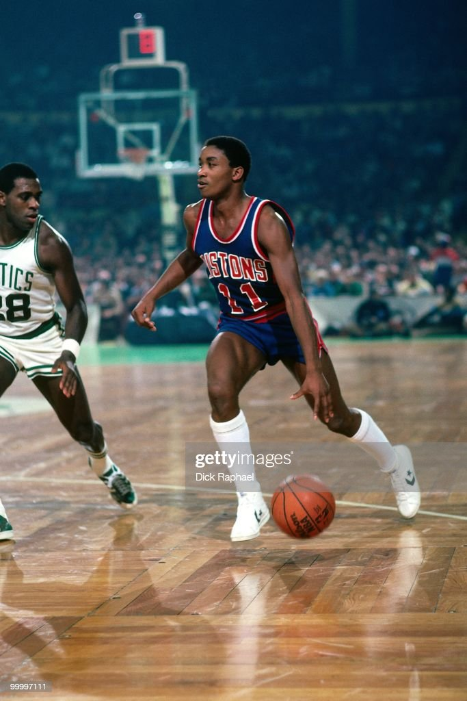 Isiah Thomas #11 of the Detroit Pistons moves the ball up court against Quinn Buckner #28 of the Boston Celtics during a game played in 1983 at the Boston Garden in Boston, Massachusetts.