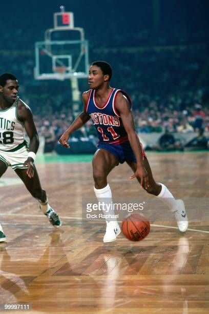 Isiah Thomas of the Detroit Pistons moves the ball up court against Quinn Buckner of the Boston Celtics during a game played in 1983 at the Boston...
