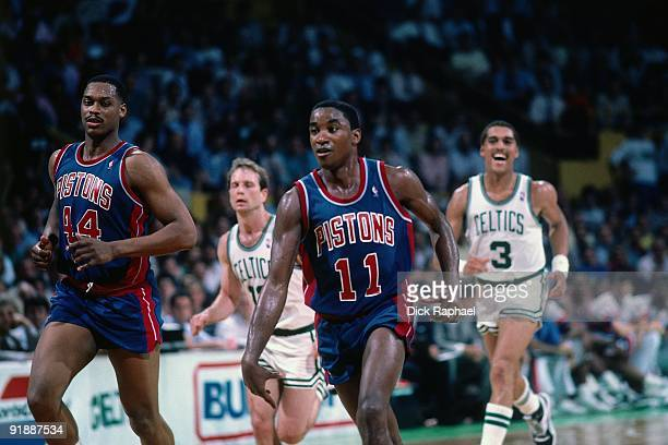 Isiah Thomas of the Detroit Pistons moves the ball up court past Jerry Sichting and Dennis Johnson of the Boston Celtics during a game played in 1987...