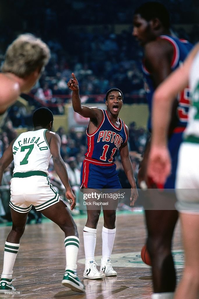 Isiah Thomas #11 of the Detroit Pistons runs the offense against Nate 'Tiny' Archibald #7 and the Boston Celtics during a game played in 1983 at the Boston Garden in Boston, Massachusetts.