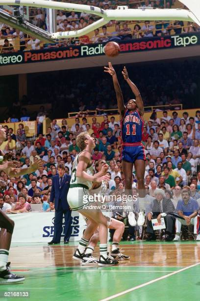 Isiah Thomas of the Detroit Pistons Shoots a jump shot against the Boston Celtics during an NBA game in 1987 at the Boston Garden in Boston...