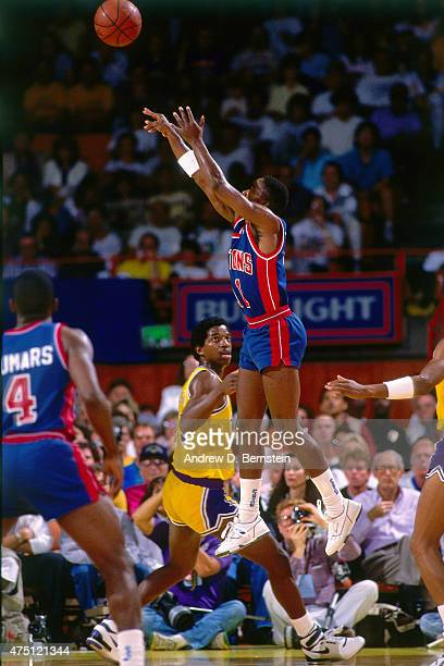 Isiah Thomas of the Detroit Pistons shoots against the Los Angeles Lakers during Game Six of the 1988 WNBA Finals on June 19 1988 at the Great...