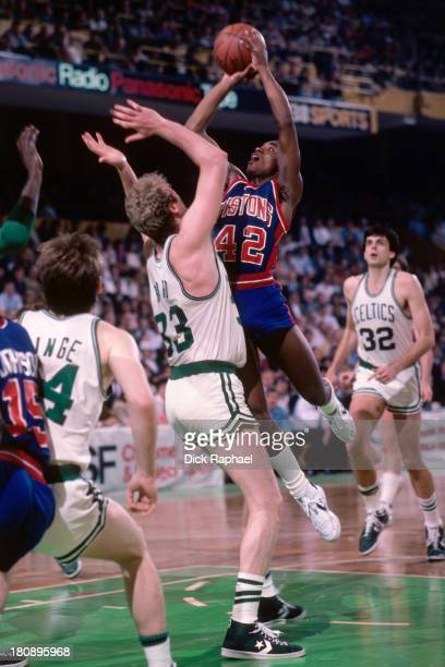 Isiah Thomas of the Detroit Pistons shoots over Larry Bird of the Boston Celtics during a game circa 1985 at the Boston Garden in Boston...