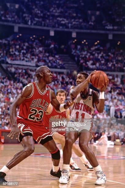 Isiah Thomas of the Detroit Pistons stops his drives against Michael Jordan of the Chicago Bulls during an NBA game in 1988 at The Palace in Auburn...