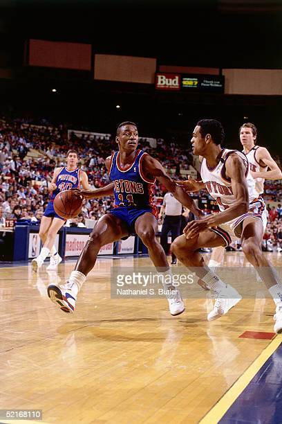 Isiah Thomas of the Detroit Pistons stops his drives against the New York Knicks during an NBA game in 1989 at Madison Square Garden in New York New...
