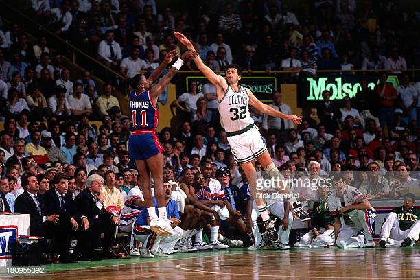 Isiah Thomas of the Detroit Pistons takes a shot againest Kevin McHale of the Boston Celtics during a game played in 1988 at the Boston Garden in...