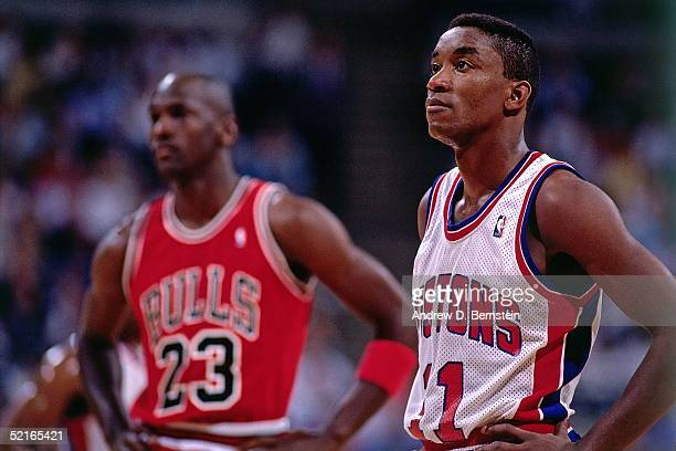 Isiah Thomas of the Detroit Pistons takes some time to catch his breath with Michael Jordan of the Chicago Bulls during a break in the action during...
