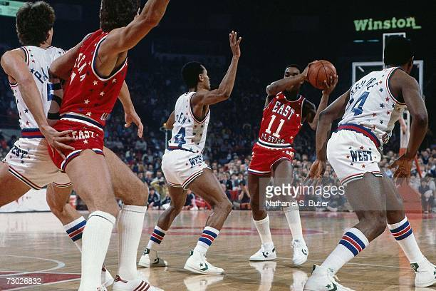 Isiah Thomas of the Eastern Conference AllStars attempts an entry pass against the Western Conference AllStars during the 1984 NBA AllStar game at...