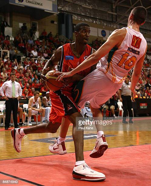 Isiah Victor of the Wildcats drives to the basket and gets fouled by Russell Hinder during the NBL quarter final match between the Perth Wildcats and...