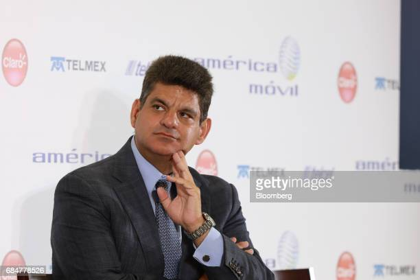 Isidoro Ambe director of corporate markets at Telefonos de Mexico SAB listens during a press conference at America Movil SAB headquarters in Mexico...