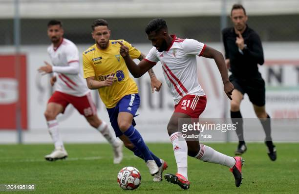 Isidoro Hinestroza of UD Vilafranquense with Lucas Marques of GD Estoril Praia in action during the Liga Pro match between GD Estoril Praia and UD...