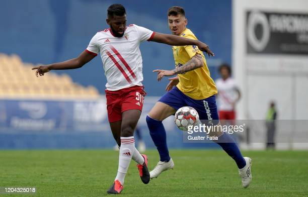 Isidoro Hinestroza of UD Vilafranquense with Lucas of GD Estoril Praia in action during the Liga Pro match between GD Estoril Praia and UD...
