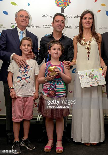 Isidro Faine Xavi Hernandez and Nuria Cunillera attend the inauguration of a new childern's wing at Hospital Sant Joan de Deu on June 2 2015 in...
