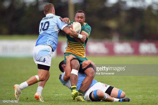 Isireli Masiwini of Mid Canterbury is tackled during the round six Heartland Championship match between Mid Canterbury and East Coast on September 29...