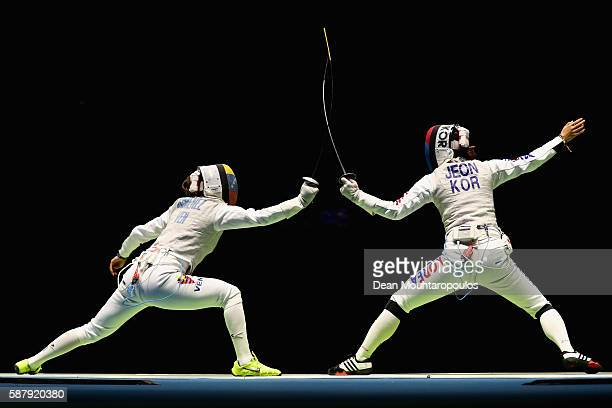 Isis Gimenez of Venezuela and Hee Sook Jeon of Korea compete during the women's individual foil on Day 5 of the Rio 2016 Olympic Games at Carioca...