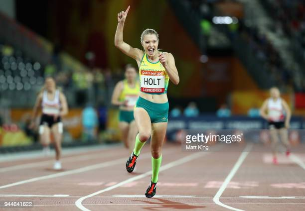 Isis Holt of Australia celebrates winning gold as she crosses the line in the Women's T35 100 metresduring athletics on day seven of the Gold Coast...