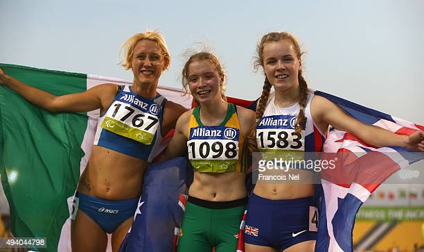 Isis Holt of Australia celebrates winning the women's 200m T35 final with Maria Lyle of Great Britain and Oxana Corso of Italy during the Evening...