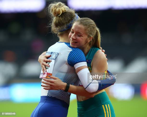 Isis Holt of Australia celebrates World Record with Maria Lyle of Great Britain Women's 100m F35 Final during World Para Athletics Championships at...