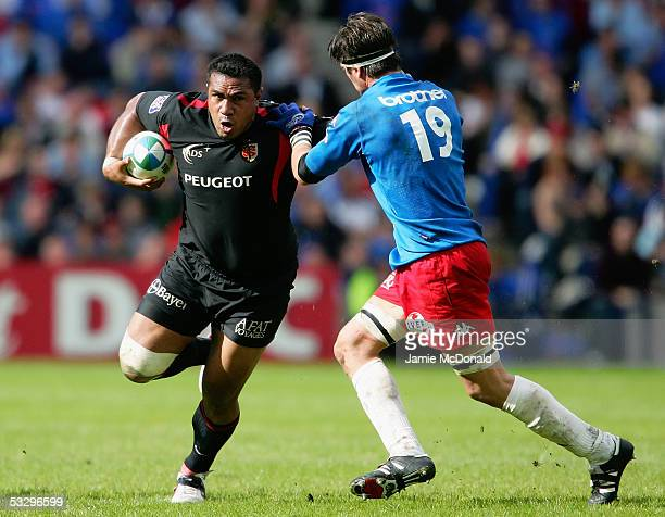 Isitolo Maka of Toulouse fends off Pierre Rabadan of Stade Francais during the Heineken Cup Final between Stade Francais and Toulouse at Murrayfield...
