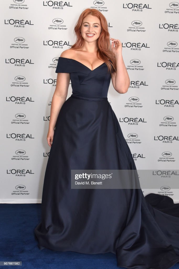 Iskra Lawrence achieved her shimmering, on trend rose gold hair colour, using L'Oreal Paris' at home colour - Preference Infinia in shade 8-23at Martinez Hotel on May 12, 2018 in Cannes, France.