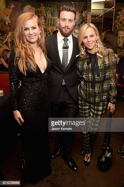 """Isla Fisher, Aaron Taylor Johnson, and Tory Burch attend the New York Premiere of Tom Ford's """"Nocturnal Animals"""" at Monkey Bar on November 17, 2016..."""