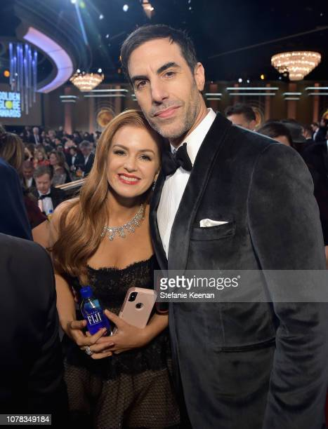 Isla Fisher and Sacha Baron Cohen attend FIJI Water at the 76th Annual Golden Globe Awards on January 6, 2019 at the Beverly Hilton in Los Angeles,...