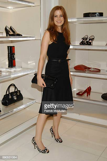 Isla Fisher attends Heidi Klum and Michael Kors from the Emmy nominated Project Runway host an Intimate Summer Cocktail Party at Michael Kors Store...