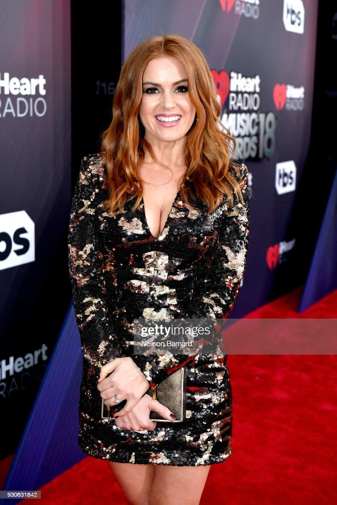 Isla Fisher attends the 2018 iHeartRadio Music Awards which broadcasted live on TBS, TNT, and truTV at The Forum on March 11, 2018 in Inglewood, California.