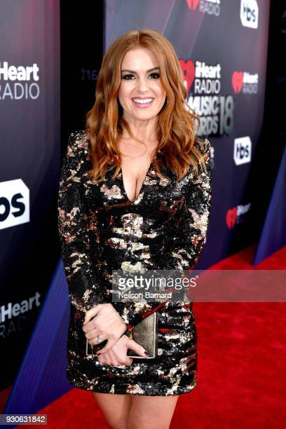 Isla Fisher attends the 2018 iHeartRadio Music Awards which broadcasted live on TBS TNT and truTV at The Forum on March 11 2018 in Inglewood...