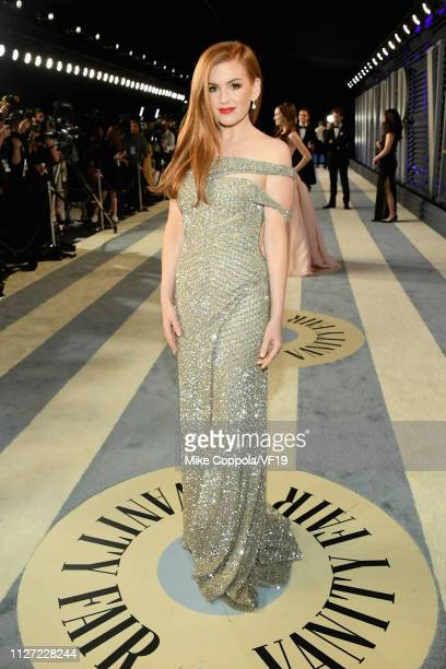 Isla Fisher attends the 2019 Vanity Fair Oscar Party hosted by Radhika Jones at Wallis Annenberg Center for the Performing Arts on February 24 2019...