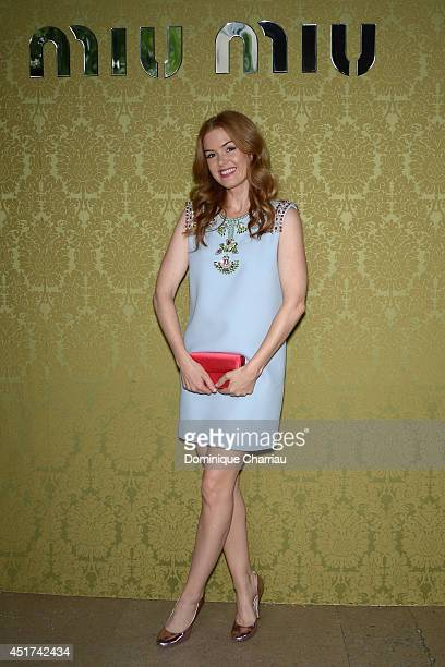 Isla Fisher attends the Miu Miu Resort Collection 2015 at Palais d'Iena on July 5 2014 in Paris France