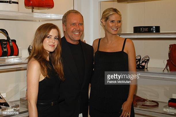 Isla Fisher Michael Kors and Heidi Klum attend Heidi Klum and Michael Kors from the Emmy nominated Project Runway host an Intimate Summer Cocktail...