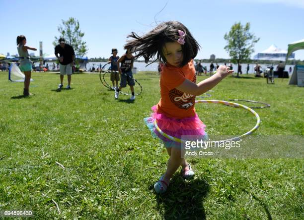 Isla Hannan displays excellent hula hoop skills at the 10th annual National Get Outdoors Day June 10 2017 at Sloan's Lake in Denver Free outdoors...