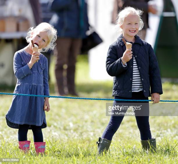 Isla Phillips and Savannah Phillips eat ice creams as they attend the Whatley Manor Horse Trials at Gatcombe Park on September 9 2017 in Stroud...