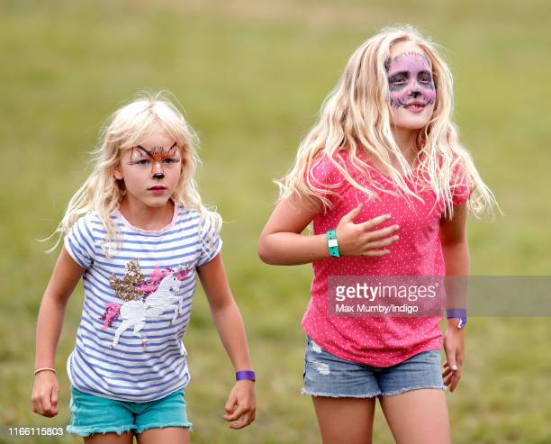 Isla Phillips and Savannah Phillips seen wearing animal design face paint attend day 3 of the 2019 Festival of British Eventing at Gatcombe Park on...