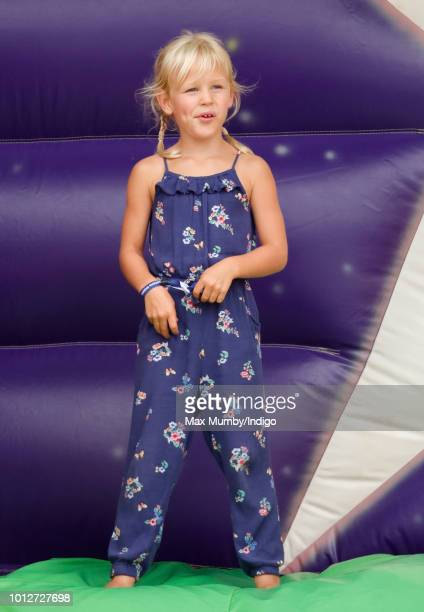 Isla Phillips plays on an inflatable bouncy slide as she attends day 1 of The Festival of British Eventing at Gatcombe Park on August 3 2018 in...