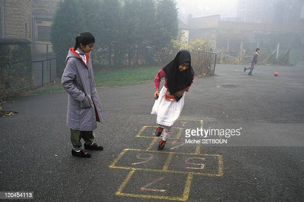 Islam in Birmingham United Kingdom In a public school playground in Batley during recess The Zacharia Girl's school a junior high Islamic school for...