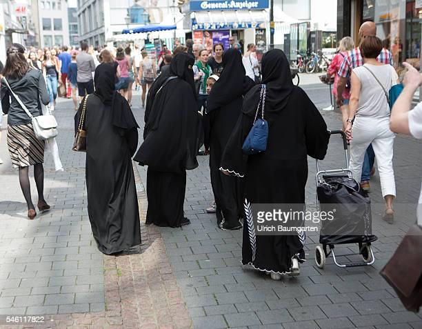 Islam in Germany Muslim woman clothed with burqa while shopping in downtown Bonn