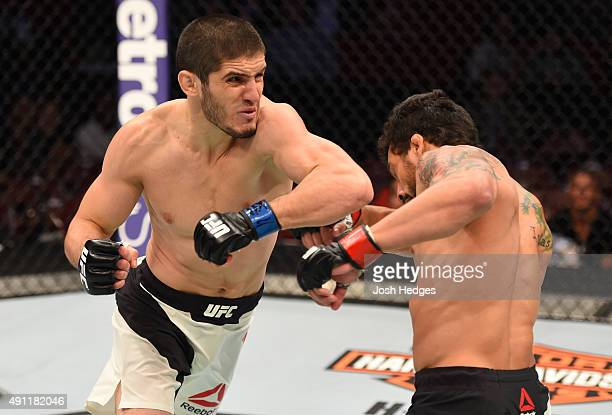 Islam Makhachev elbows Adriano Martins in their lightweight bout during the UFC 192 event at the Toyota Center on October 3 2015 in Houston Texas