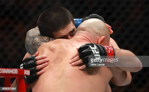 Islam Makhachev embraces Gleison Tibau after his first round knockout in their Lightweight fight during UFC 220 at TD Garden on January 20 2018 in...