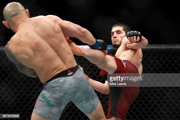 Islam Makhachev kicks Gleison Tibau in the first round of their Lightweight fight during UFC 220 at TD Garden on January 20 2018 in Boston...