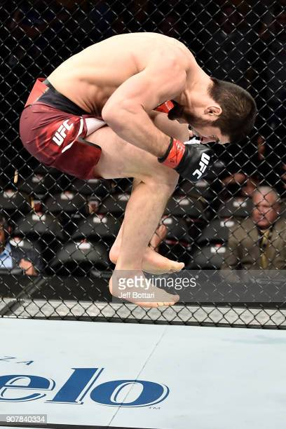 Islam Makhachev of Russia celebrates after his knockout victory over Gleison Tibau of Brazil in their lightweight bout during the UFC 220 event at TD...