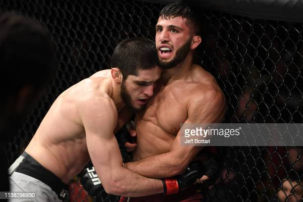 Islam Makhachev of Russia controls the body of Arman Tsarukyan of Russia in their lightweight bout during the UFC Fight Night event at Yubileyny...