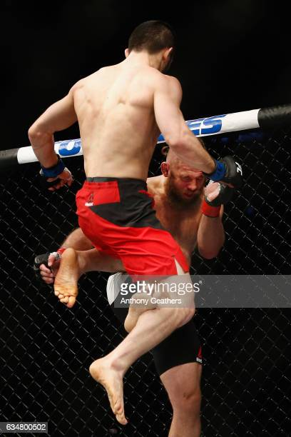 Islam Makhachev of Russia flies in the air as he lands a knee against Nik Lentz of United States in their lightweight bout during UFC 208 at the...