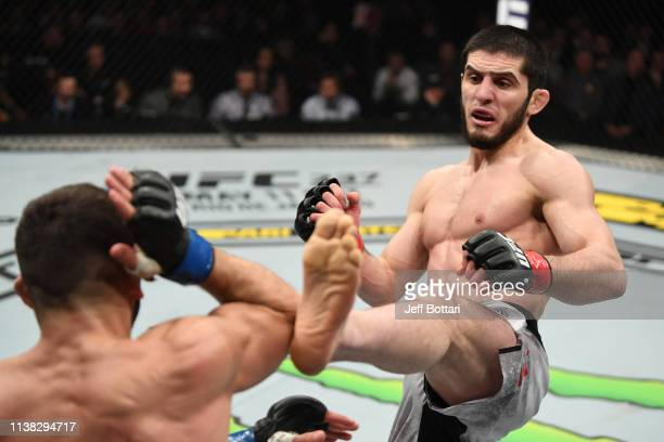 Islam Makhachev of Russia kicks Arman Tsarukyan of Russia in their lightweight bout during the UFC Fight Night event at Yubileyny Sports Palace on...
