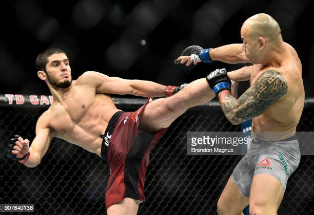 Islam Makhachev of Russia kicks Gleison Tibau of Brazil in their lightweight bout during the UFC 220 event at TD Garden on January 20 2018 in Boston...