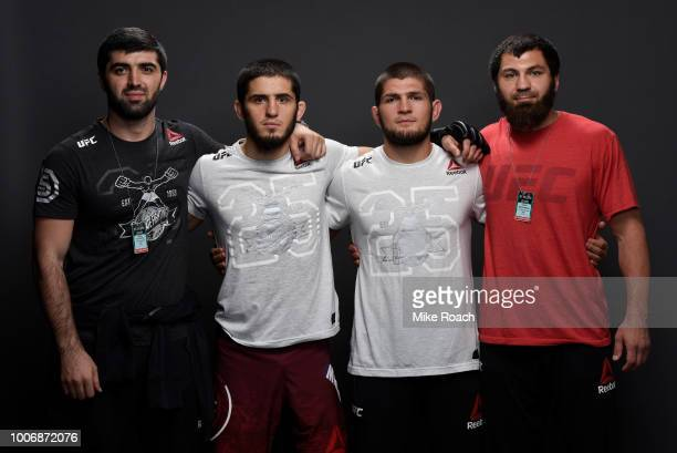 Islam Makhachev of Russia poses for a portrait backstage with his team after his victory over Kajan Johnson during the UFC Fight Night event at...