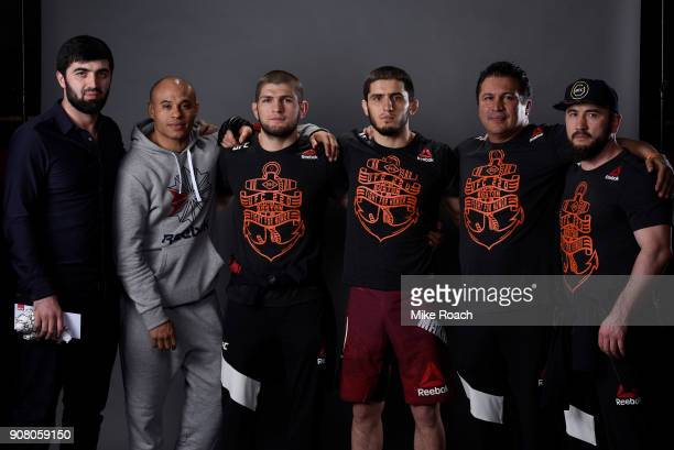 Islam Makhachev of Russia poses for a portrait backstage with his team after his victory over Gleison Tibau during the UFC 220 event at TD Garden on...